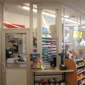 Vertical Slider with speak hole featured in a convenience store environment