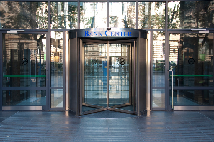 "Bank entrances may now have bullet resistant glass vestibules or even ""Mantraps""."