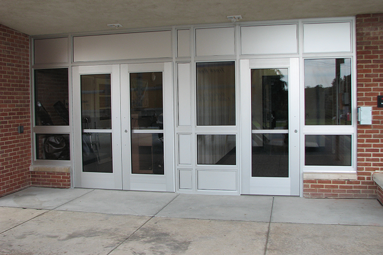 bulletproof school entryway featuring doors and windows that fit into modern building design.
