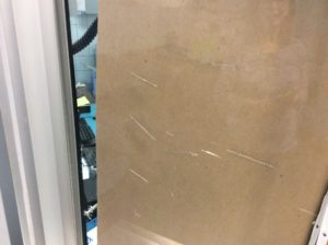 school security window damaged by cleaners