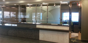 bulletproof glass barrier in business setting